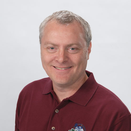 Photo of man in maroon button down polo. Tim Walters, real estate broker & owner of The Homebuyers; MN Buyers Agent.