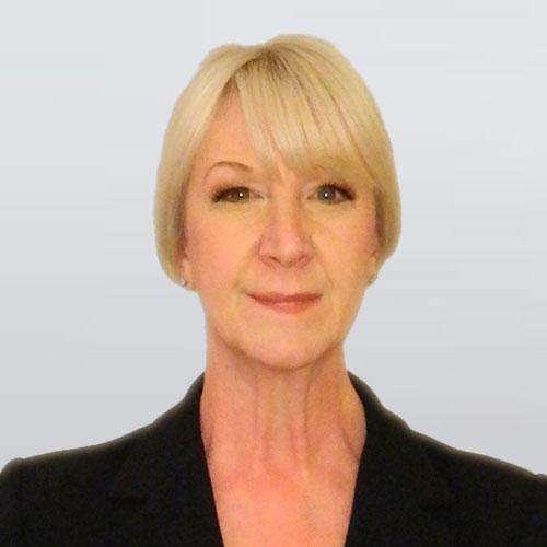 Woman with short, blonde hair in black blazer. Kathryn Hamernik, real estate & buyers agent, team member of The Homebuyers.