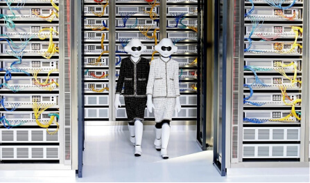 two person walking next to servers
