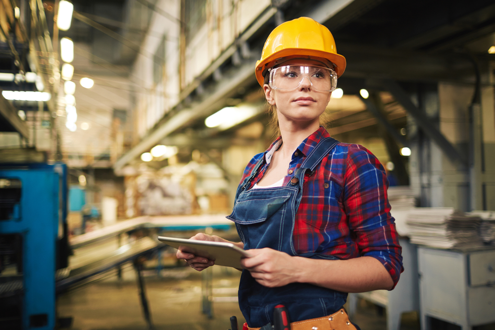 a female manufacture worker with ipad