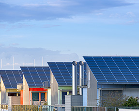 A row of house with solar panels on top