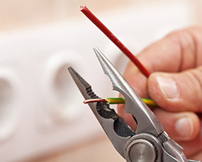An electrician cutting a wire