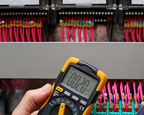 An electrician testing for voltage