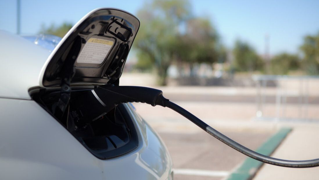 A car being charged by electricity