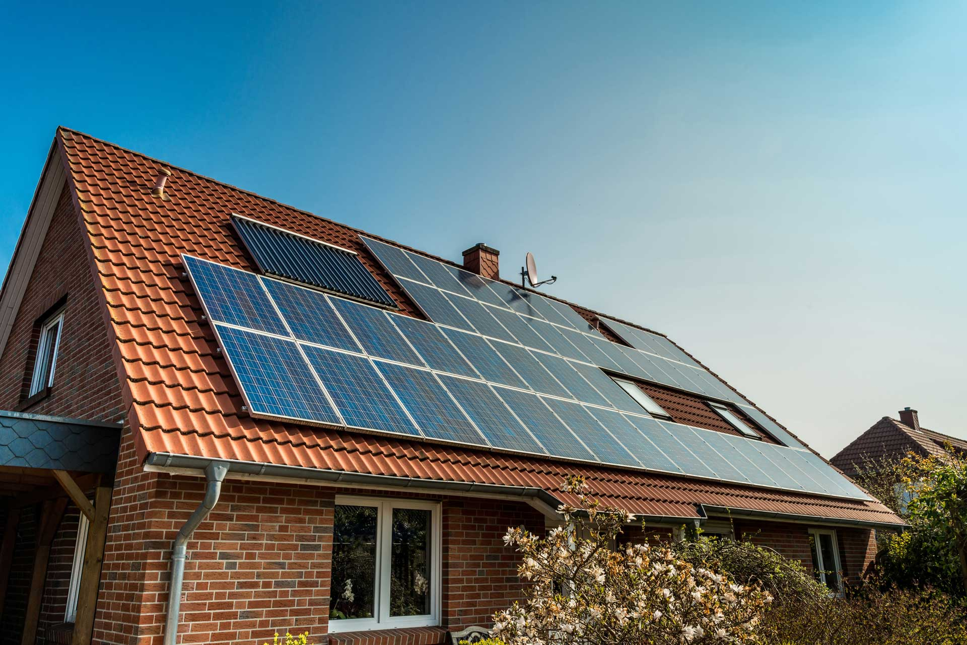 Solar panels fitted to the roof of a bungalow