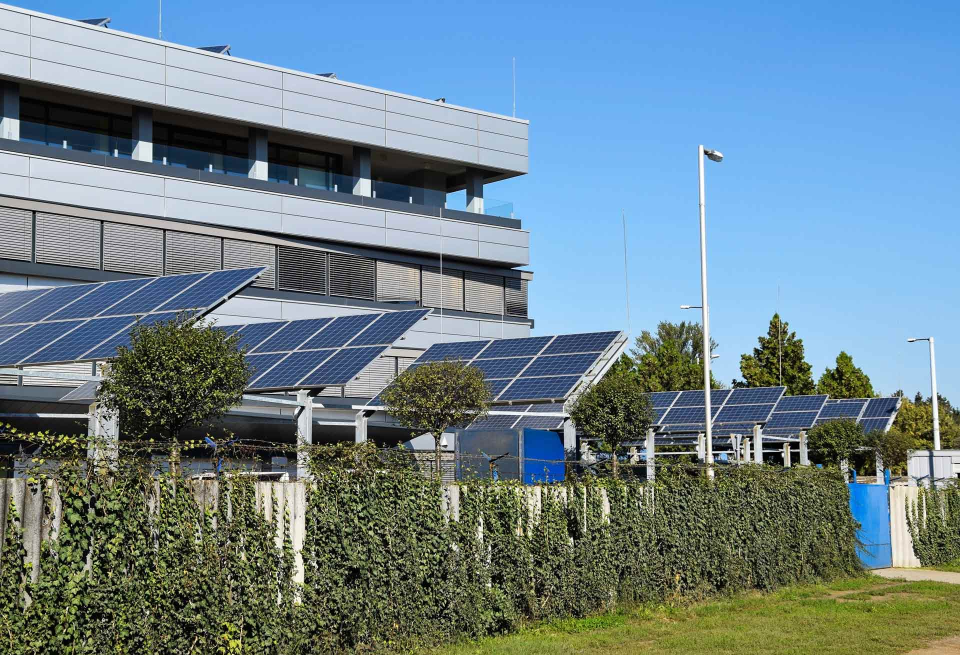 Banks of solar cells fitted outside a large industrial building