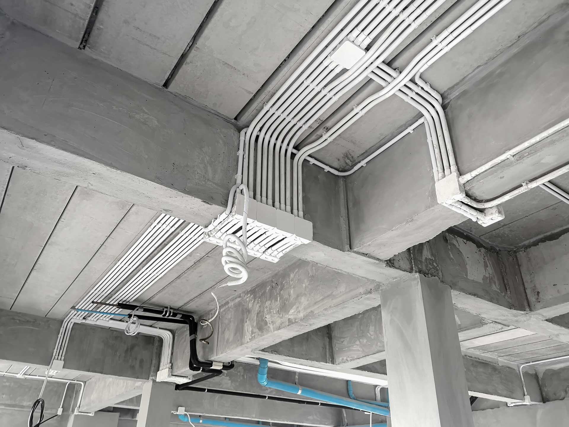 A huge run of electrical cables on a ceiling of an industrial building