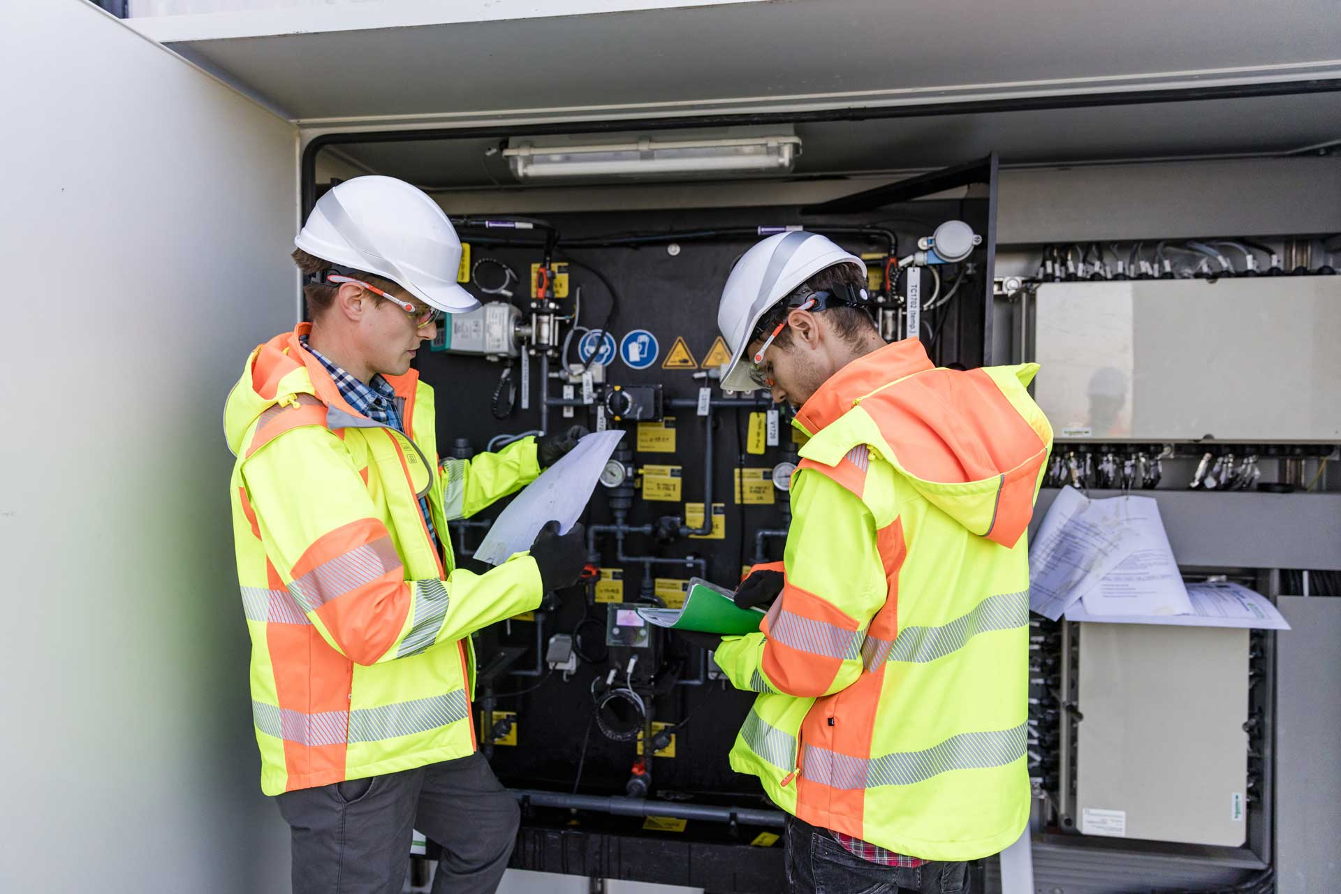 Two electrical engineers carrying out testing on an electrical installation