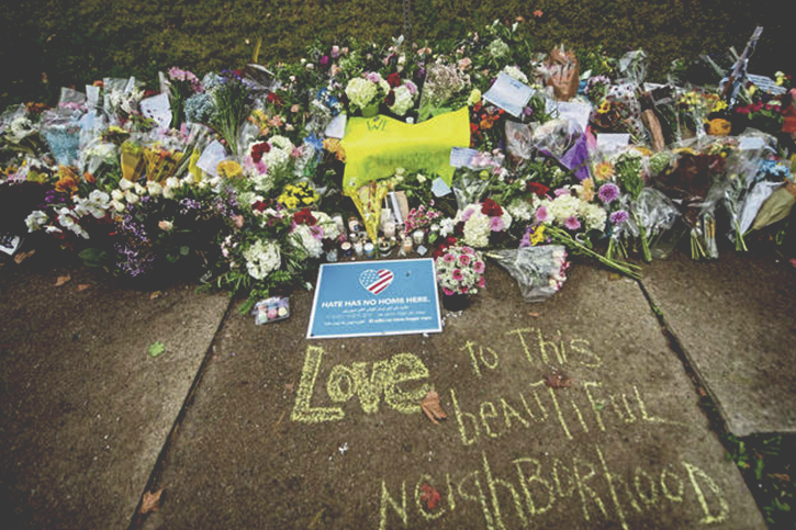 A photo of the flowers, gifts, and other items left at a memorial outside the Tree of Life Synagogue following the terrorist hate attack against Jewish congregants