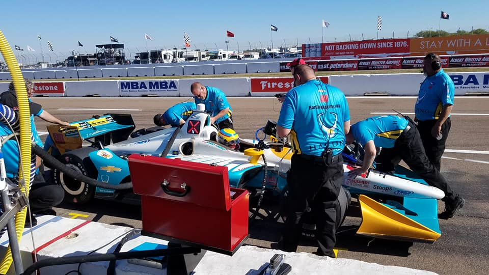 Chevrolet race car on a track at the pit stops