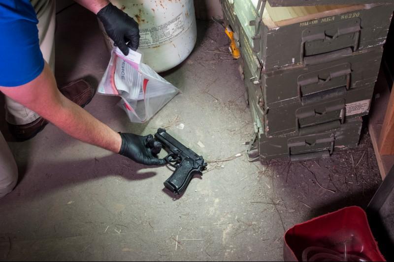 Man putting evidence into a evidence bag
