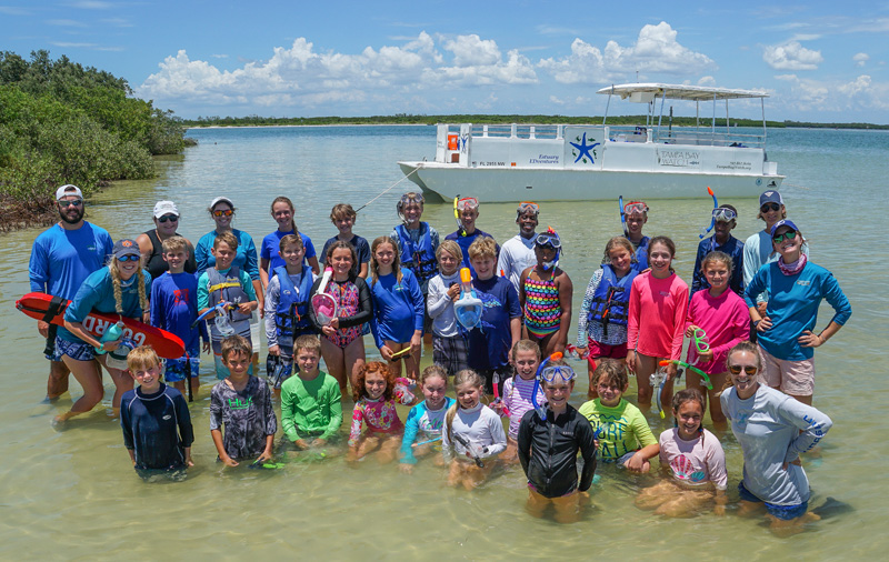 Tampa Bay Watch members gathered on the water