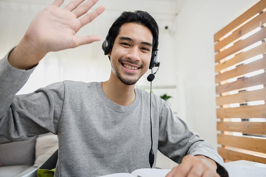 Man wearing a headset waving