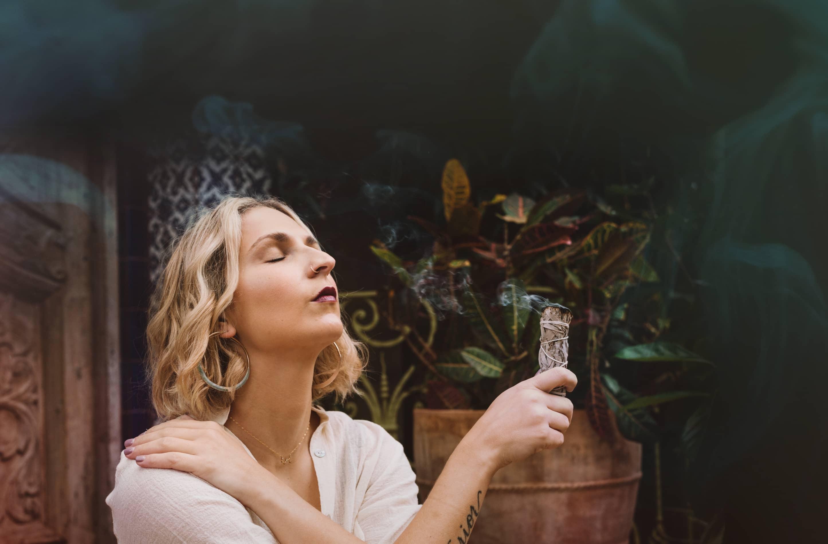 Portrait of Francesca holding sage