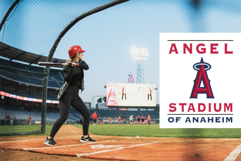 Woman playing baseball at Angel Stadium of Anaheim