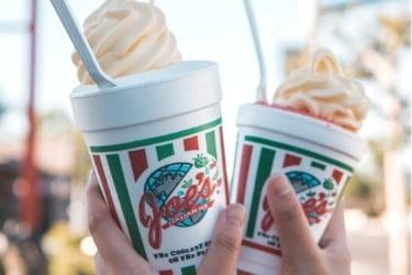 Hands holding two cups of Joe's Italian Ice cream