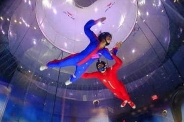 People doing indoor skydiving