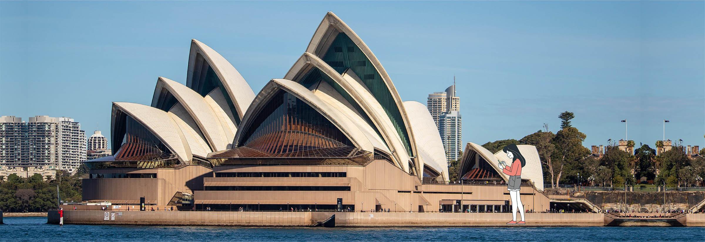 Digital nomad en visite devant l'opéra de Sydney