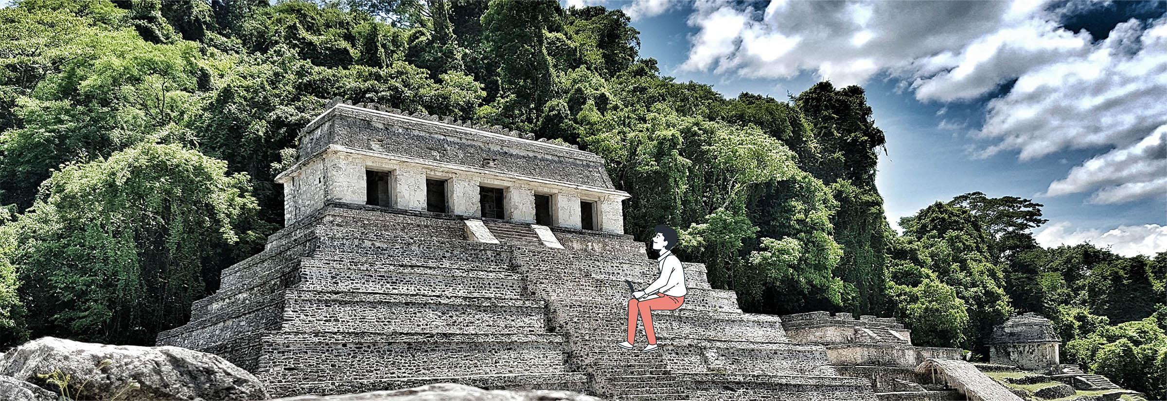 Digital nomad travaille devant des ruines amérindiennes en Amérique Centrale