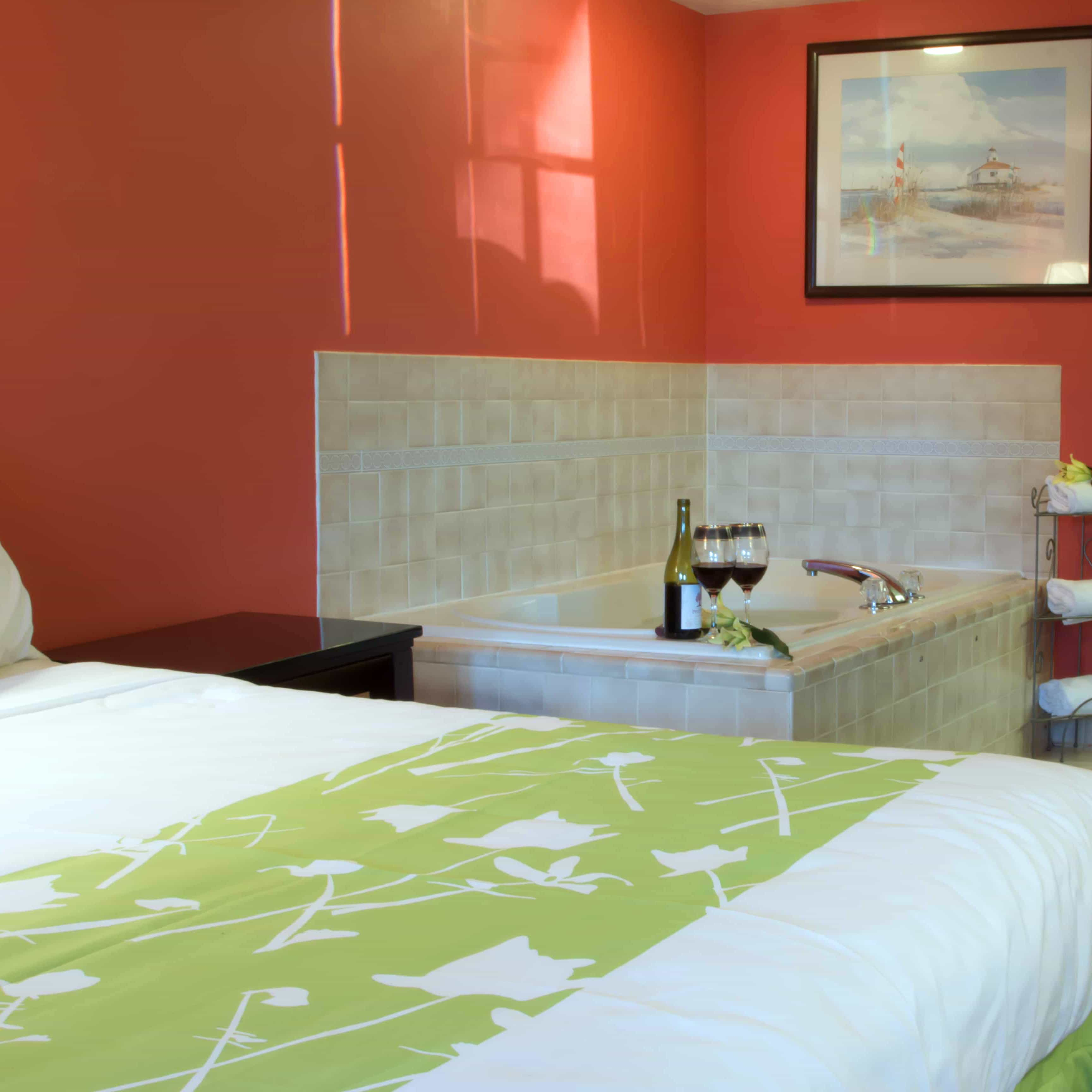 clarion guest room with wine and glasses