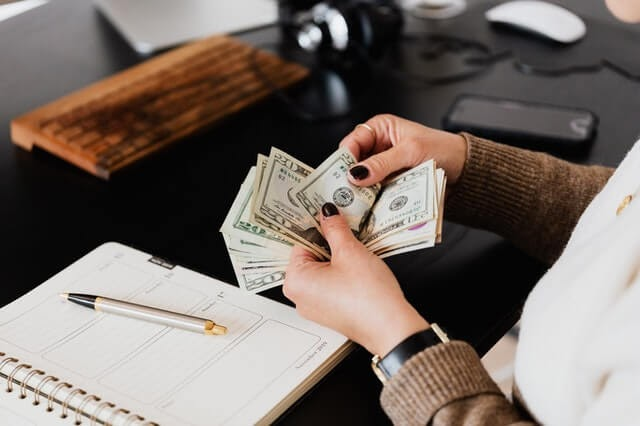 Woman counting investment money