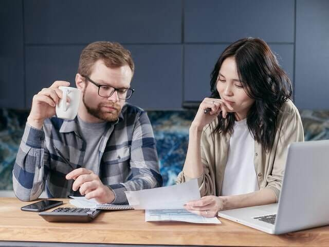 Man and woman making business decision
