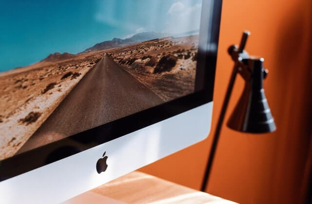 Mac monitor with Apple's brand logo