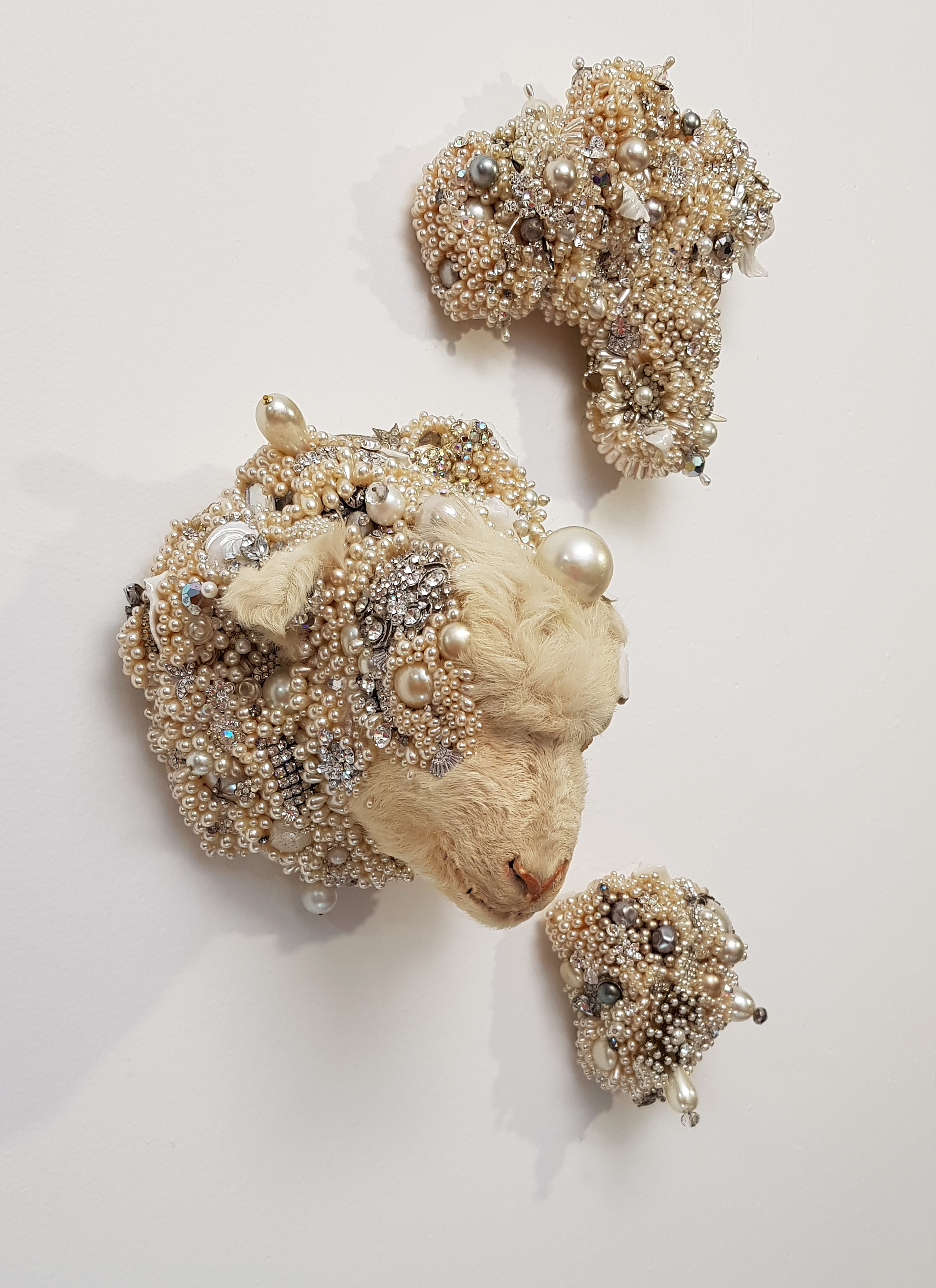 Angla Singer, Under the White (Schenck) 2021, vintage taxidermy lamb head, handmade porcelain leaves, pearls, jewels, mixed media.