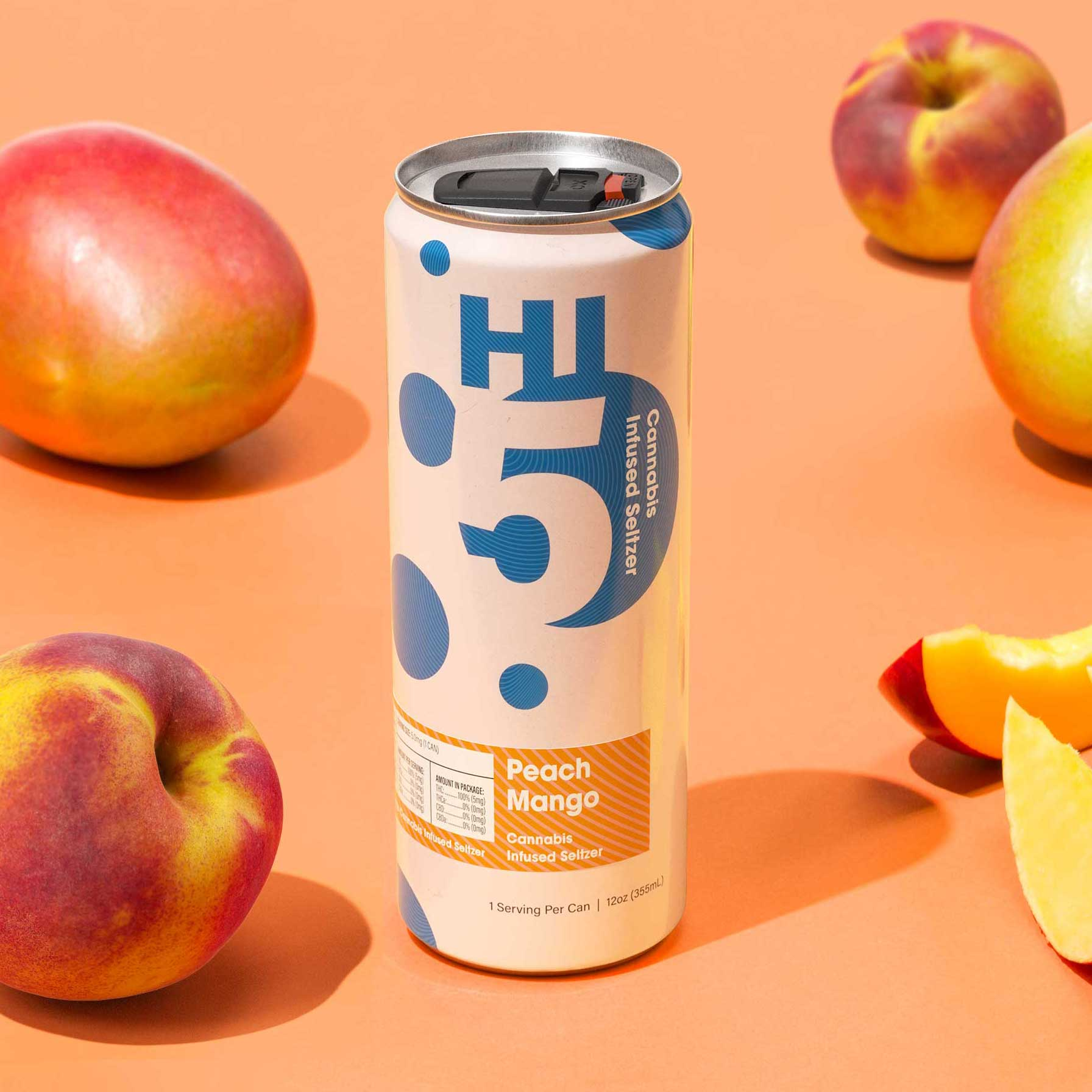 Peach Mango Hi5 surrounded by cut peaches and mangoes.