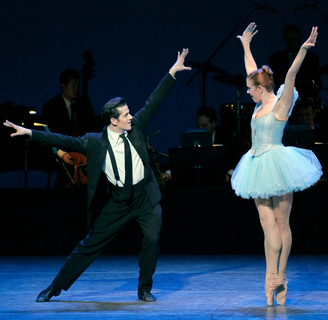 Savannah Lowery (as Blossom in a blue tutu), and Robert Fairchild (as the Musician in a black tie and suit).