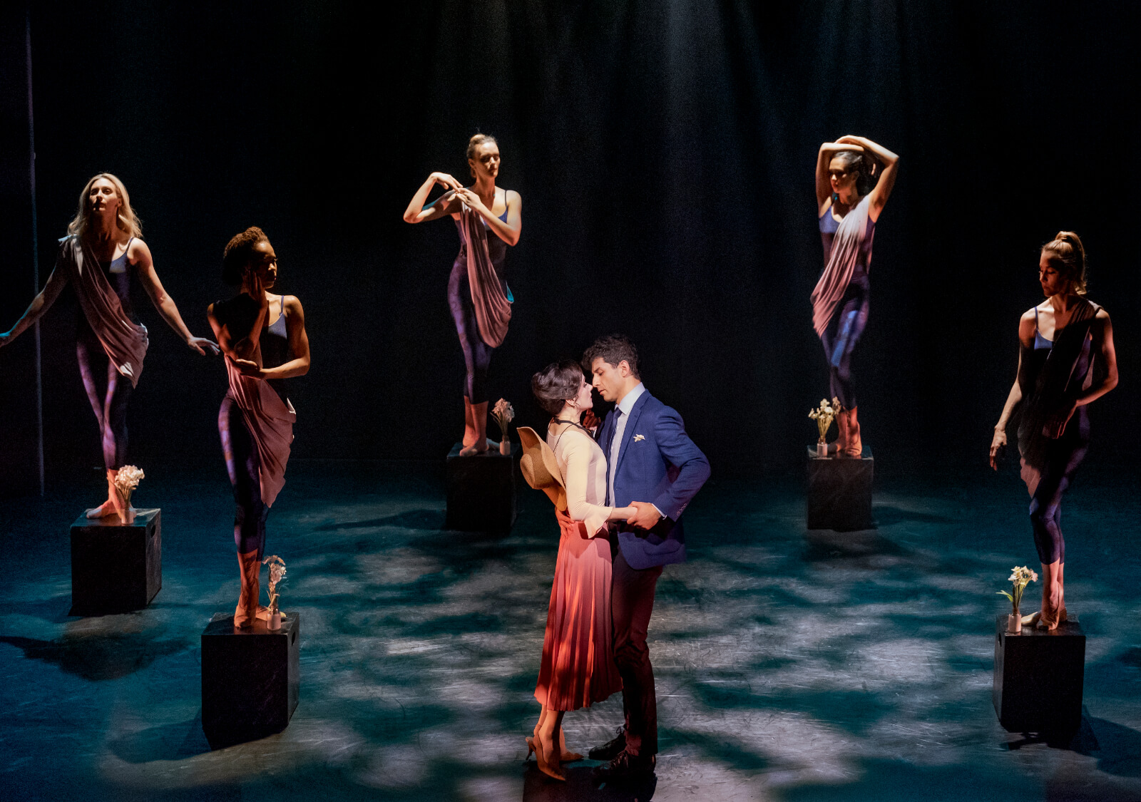 The company of The Beast in the Jungle in the Garden. The women create statues while Irina Dvororenko and Tony Yazbeck in the center.
