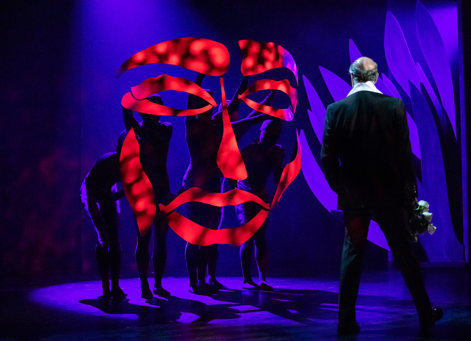 John Marcher (Peter Friedman)confronts the Beast in the Prologue. The Beast face is created by red puppetry pieces.