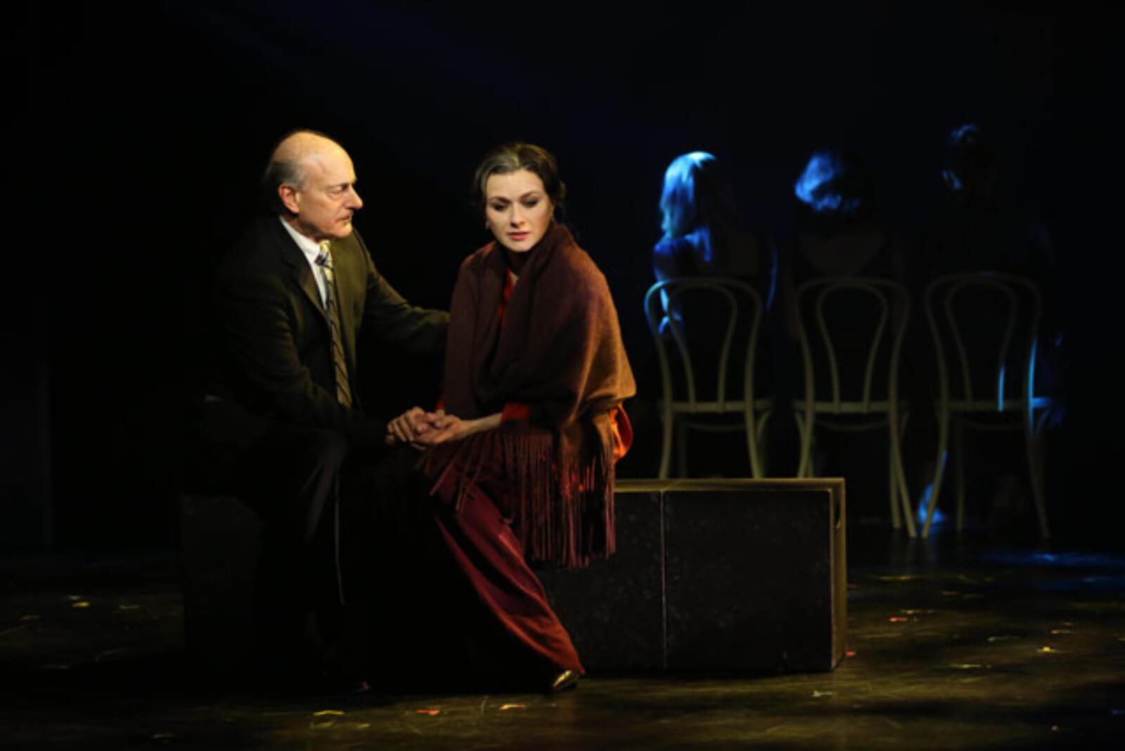 John Marcher (Peter Friedman) comforts May (Irina Dvorovenko) in of The Beast in the Jungle.