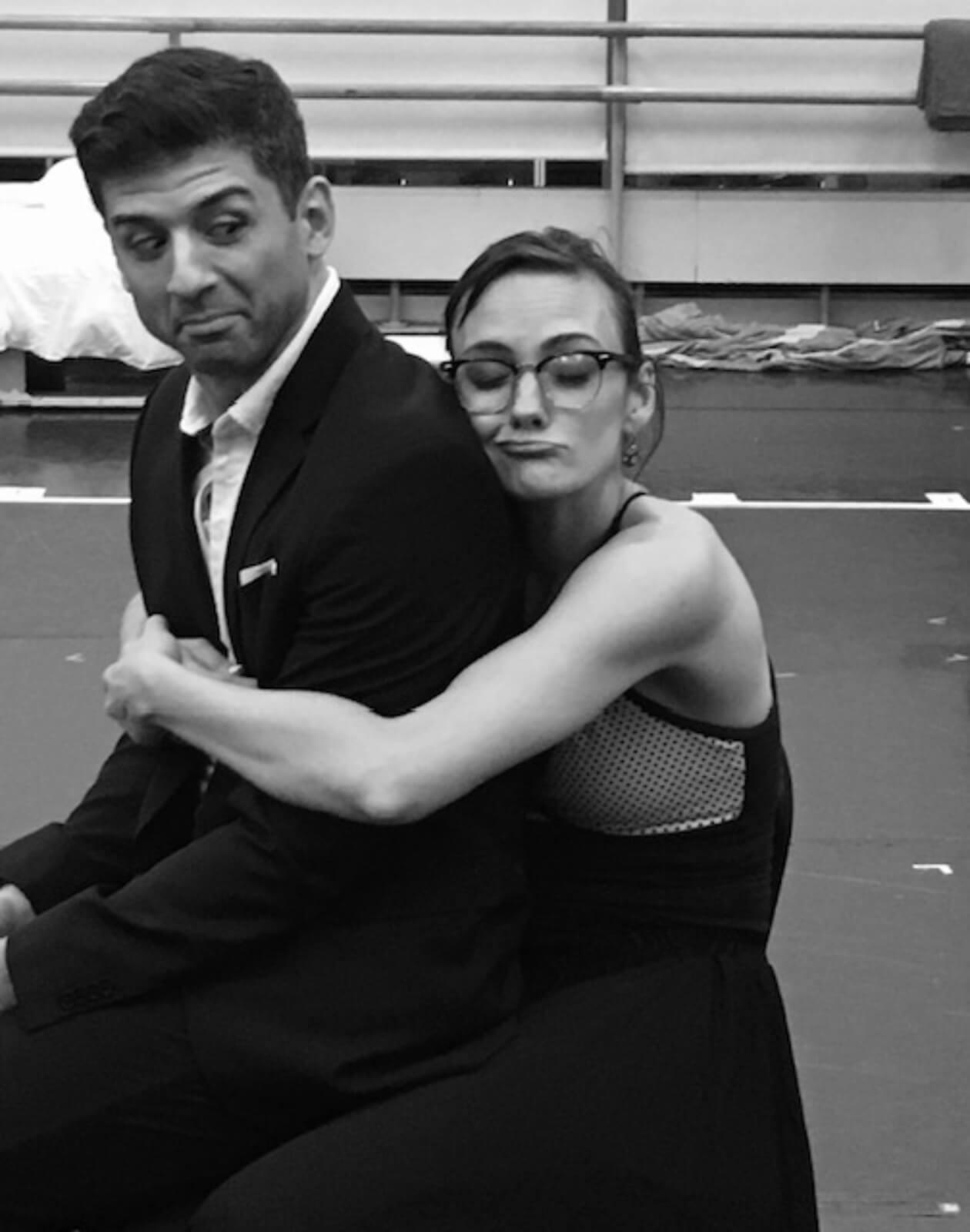 Rehearsal photo of dance captain Leah Hofmann hugging Tony Yazbeck.
