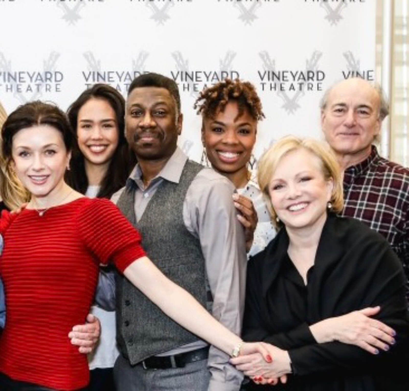 Irina Dvorovenko, Maira Barriga, Teagle F. Bougere, Erin N. Moore, Susan Stroman, and Peter Friedman in front of a step-and-repeat with Vineyard Theatre's logo.