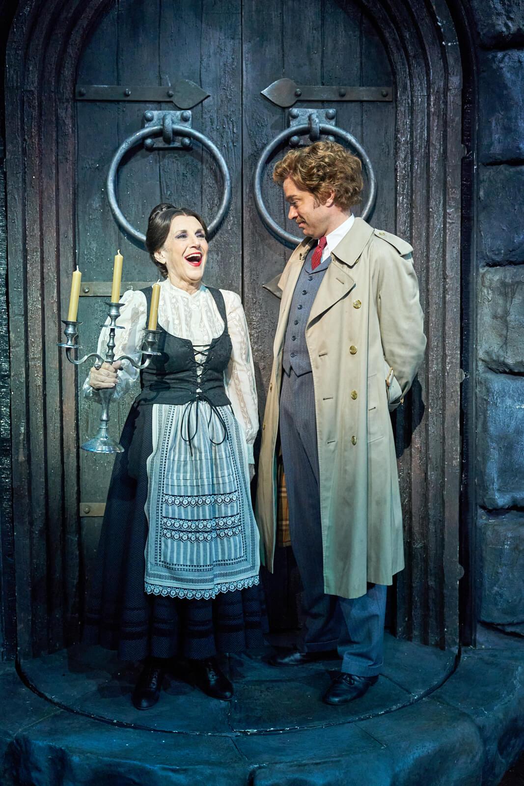 Frau Blucher(Lesley Joseph) laughing at Dr. Frankenstein (Hadley Fraser) in front of castle doors.