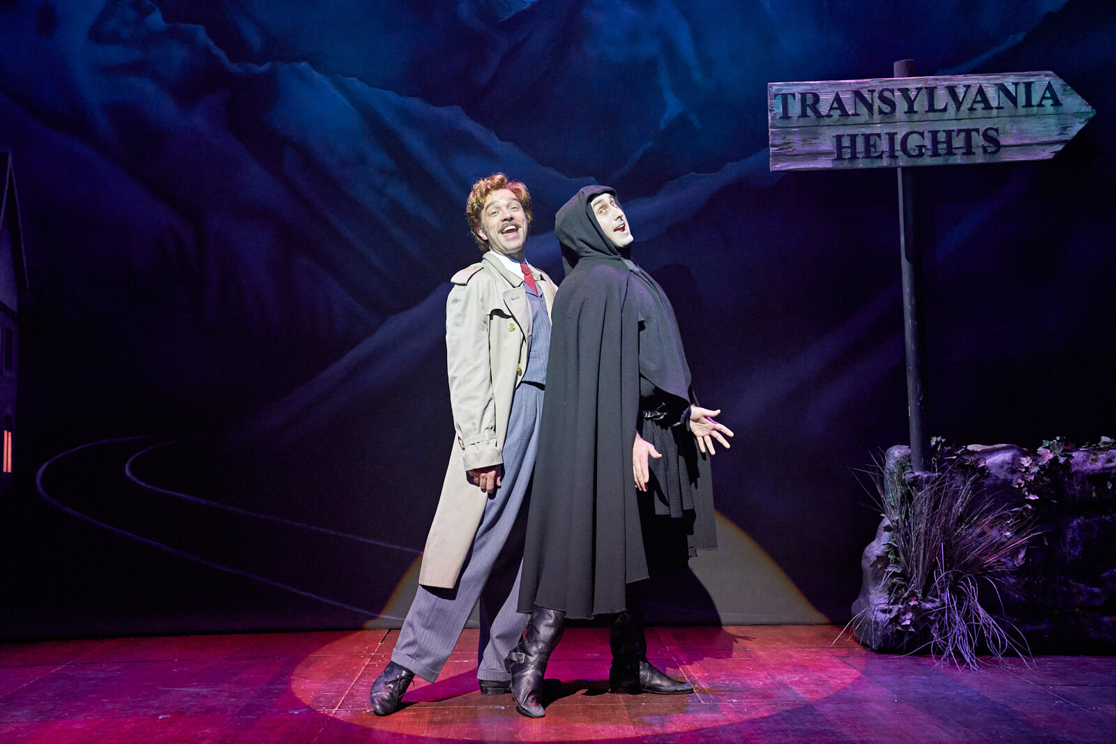 """Dr. Frankenstein (Hadley Fraser) and Igor (Ross Noble) sing """"Together Again"""". They are on their way to Transylvania Heights."""