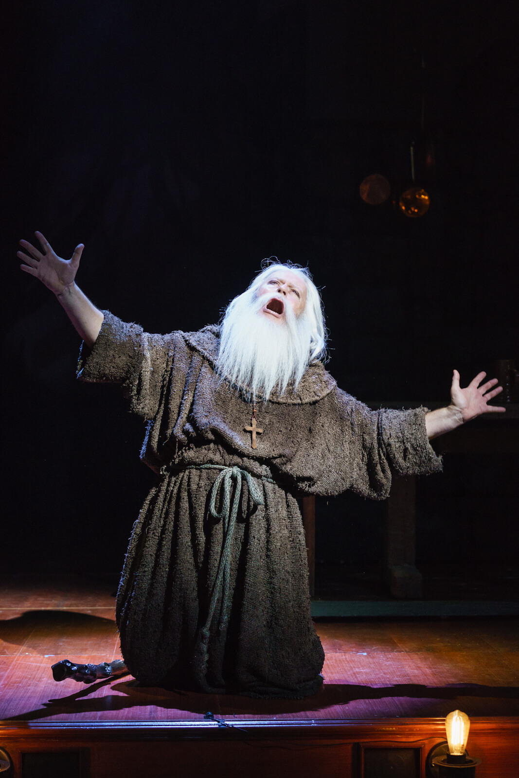 """The Hermit (Patrick Clancy) sings """"Someone"""", pleading on his knees from Young Frankenstein (West End)."""
