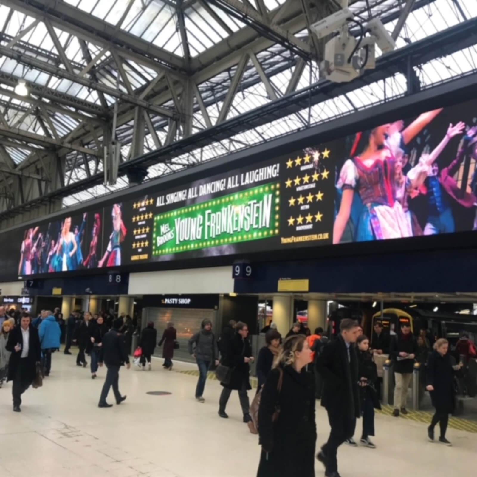 Huge banner of Young Frankenstein (West End) London at Paddington Train Station.