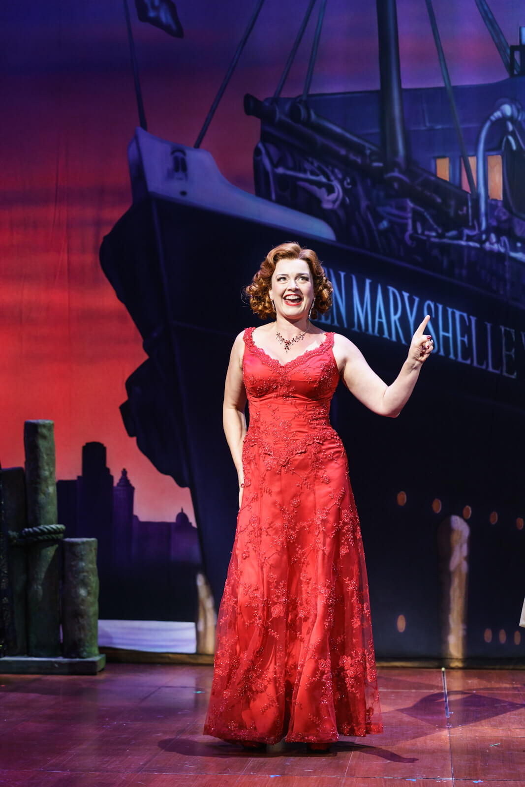 Elizabeth (Dianne Pilkington) is in a beautiful red dress saying goodbye to Frederick on the dock before he sails away to Transylvania.