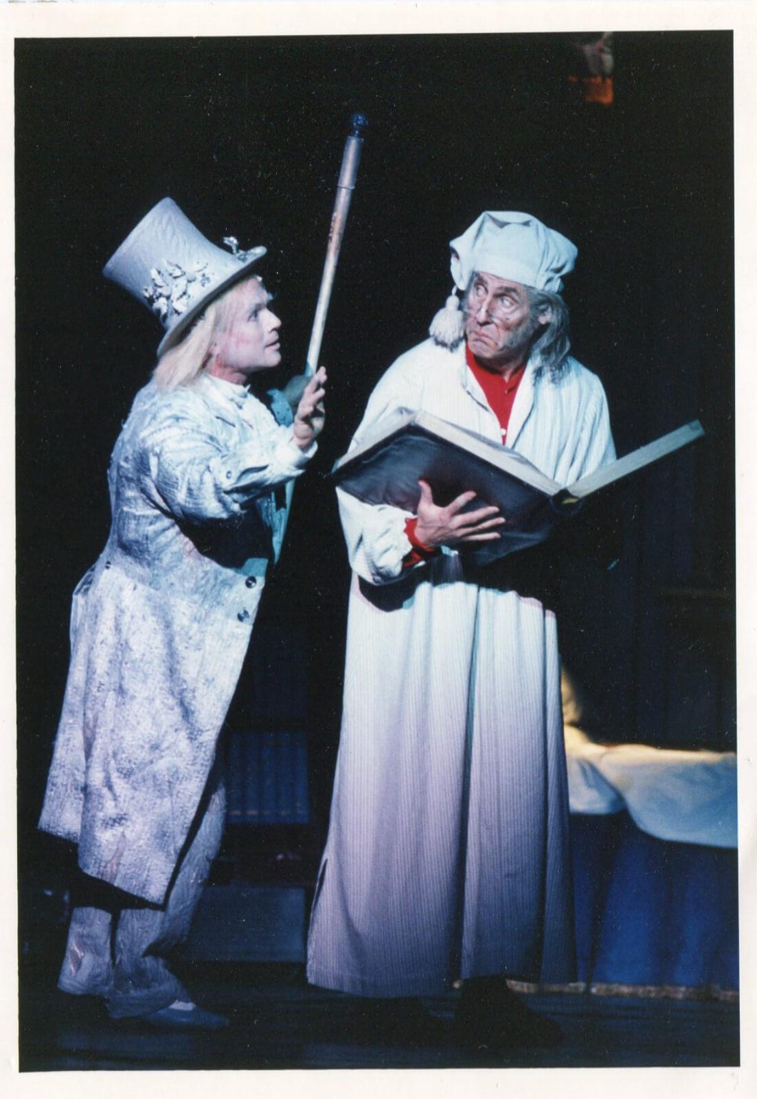 Ghost of Christmas Past (Ken Jennings) visits Ebenezer Scrooge (Roger Daltry).