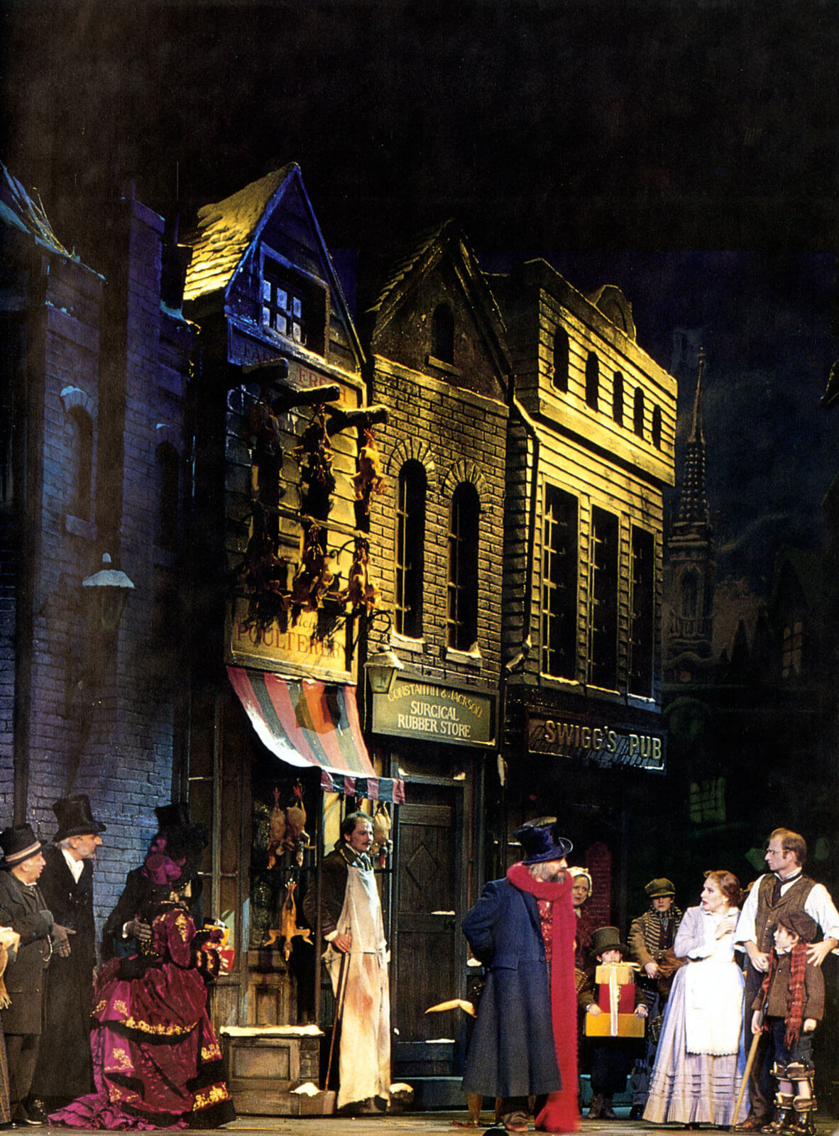 Scrooge (Walter Charles) in a street scene with the Cratchit family.