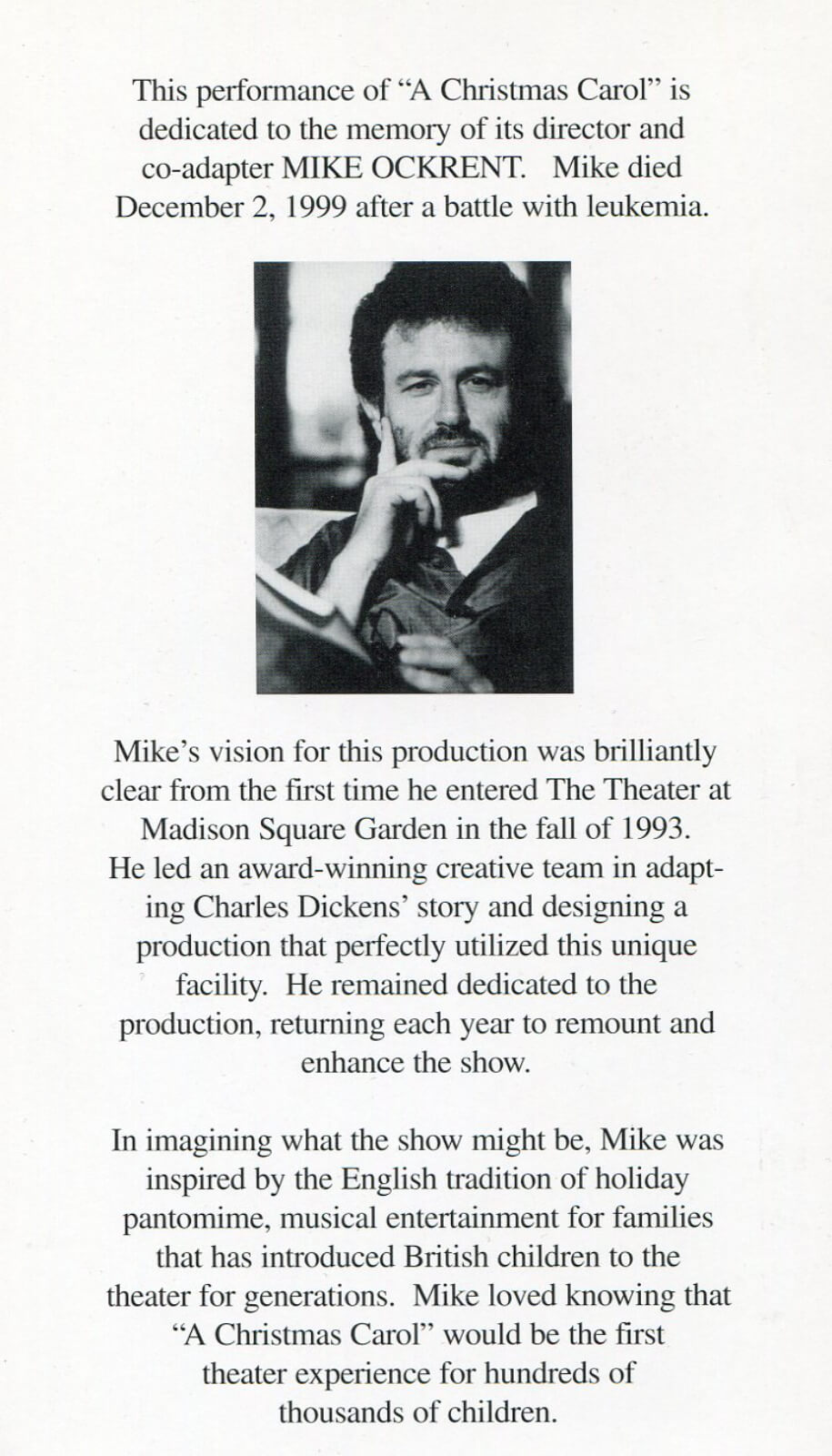 A printed dedication to Director Mike Ockrent after his passing in 1999 with a his black and white headshot featured