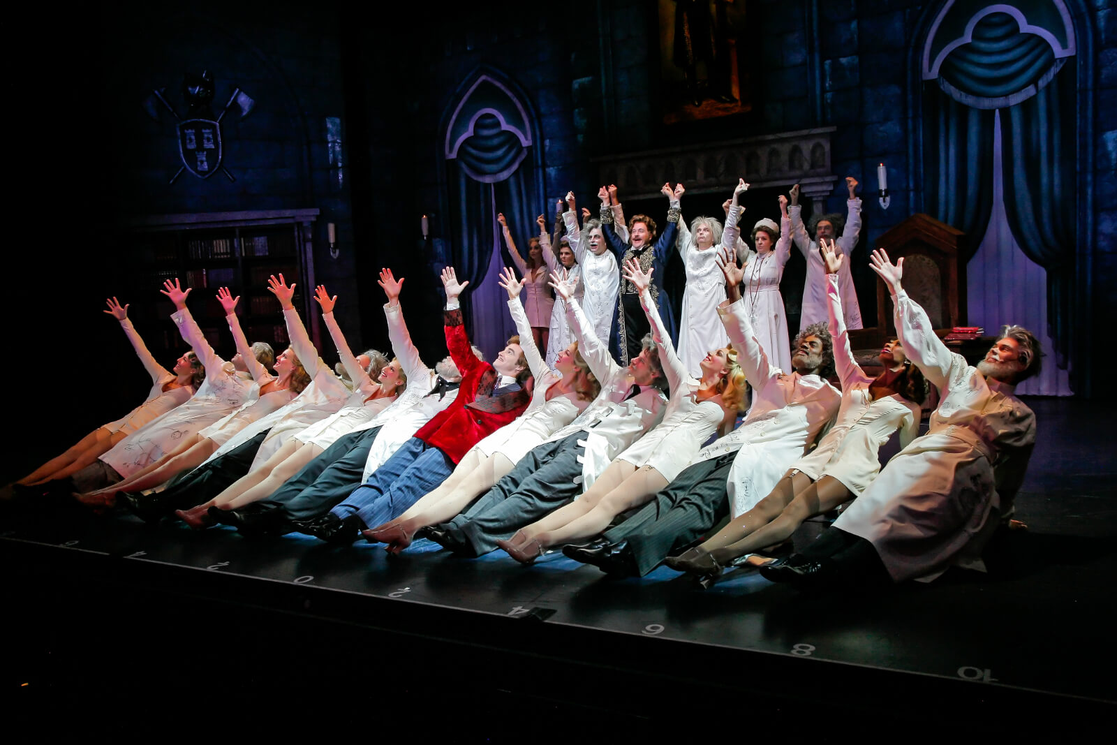 """Dr. Frankenstein (Roger Bart) and his ancestors dance to """"Join the Family Business"""". They are all doing a Russian dance step."""