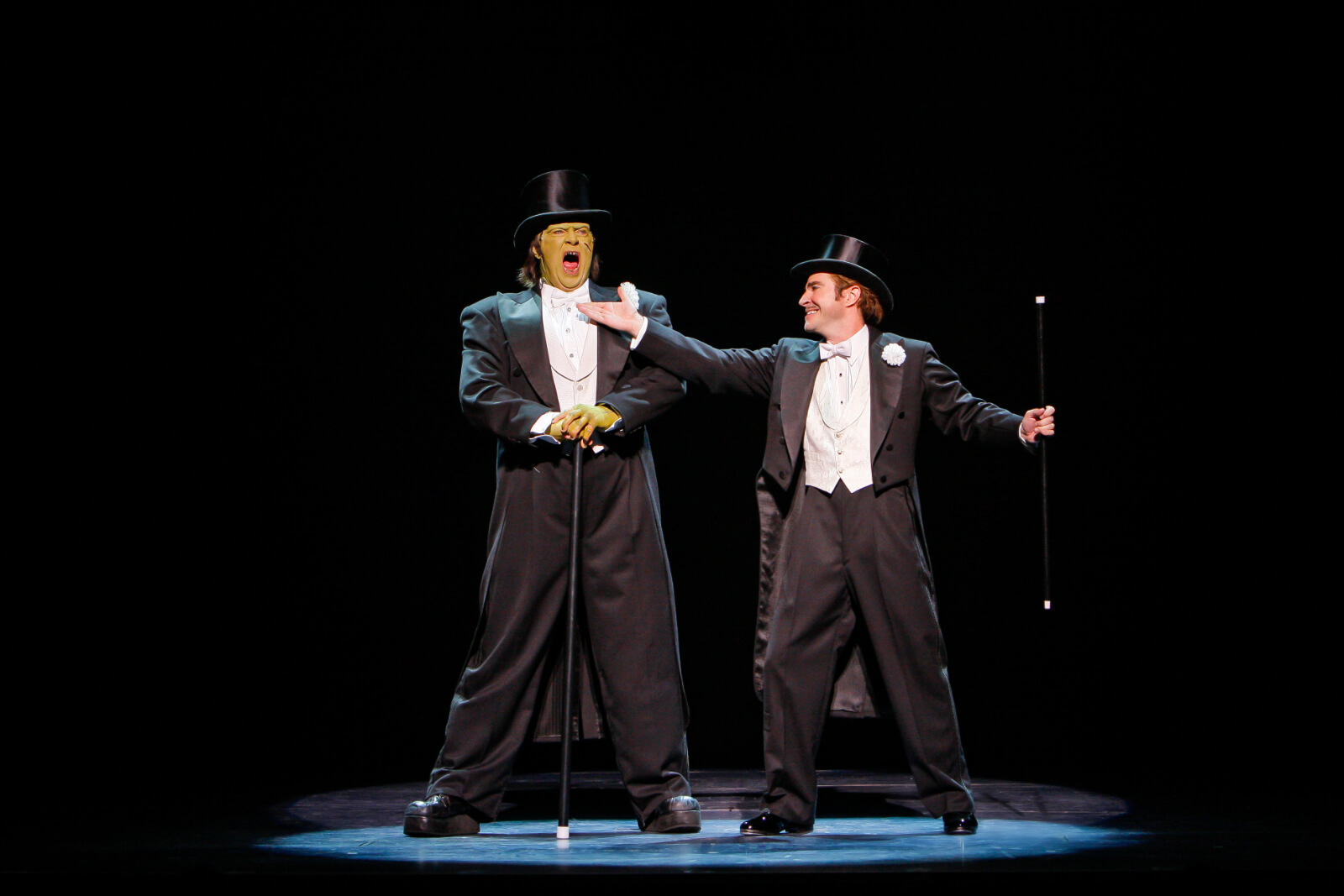 """Dr. Frankenstein (Roger Bart) invites the Monster (Shuler Hensley) to sing """"Puttin' on the Ritz"""". They are in top hat and tails holding canes."""
