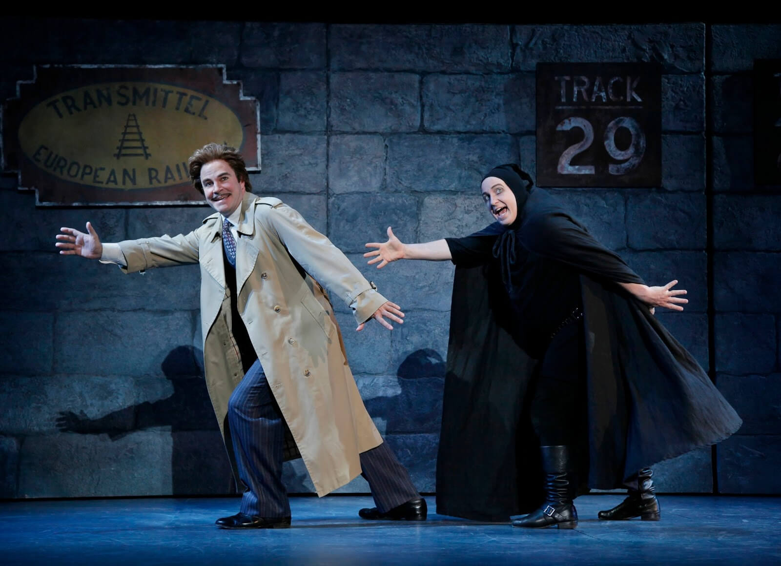 """Dr. Frankenstein (Roger Bart) dances with Igor (Cory English) to the song """"Together Again"""". They are at the Transylvania Train Station."""