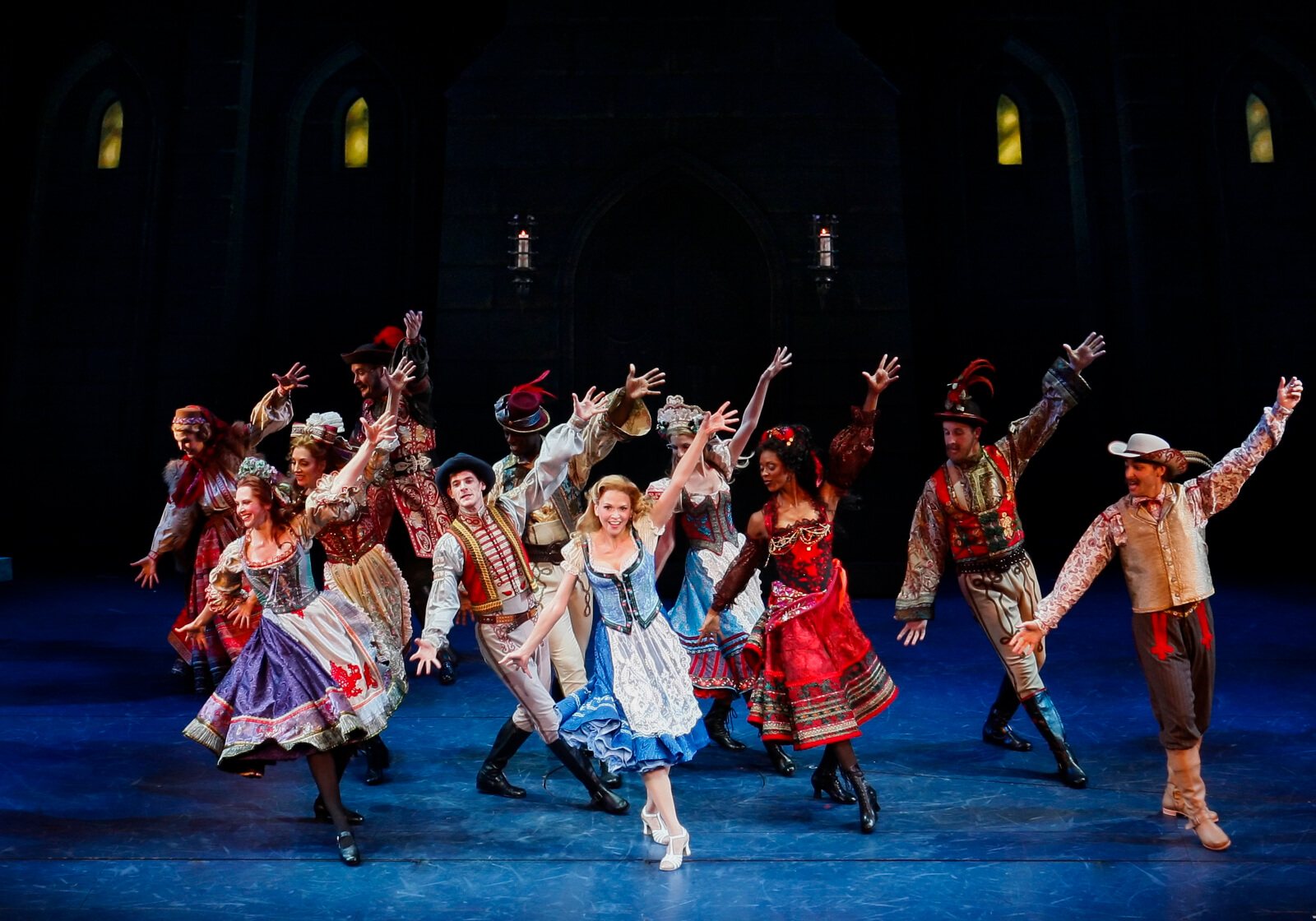 Inga (Sutton Foster) dances with the happy Villagers of Transylvania Heights.