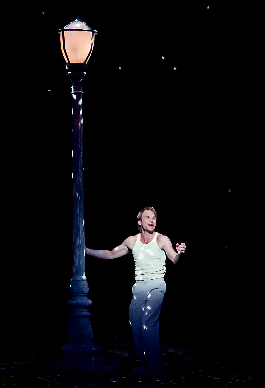 Camille Raquin (Norbert Leo Butz) expressing his feelings beside the lampost.