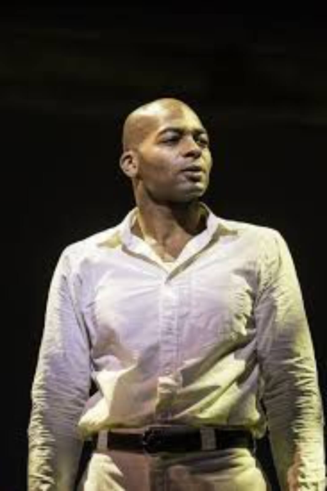 """Haywood Patterson (Brandon Victor Dixon) sings the song """"Go Back Home"""". He is wearing a white shirt and white pants. He is in his jail cell."""