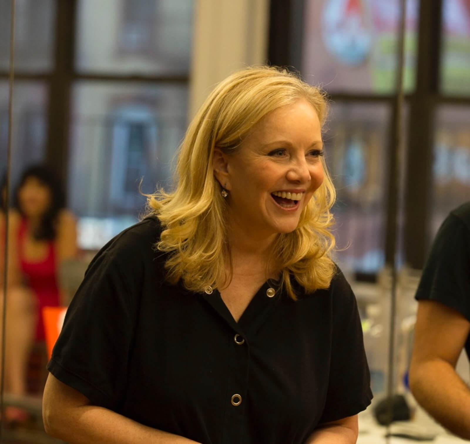 A candid photo of Susan Stroman directing rehearsals. She is explaining a comic moment in the show.